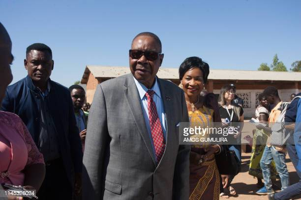 Malawi's President Arthur Peter Mutharika and first lady Gertrude Maseko Mutharika leave Goliati Primary School after voting at his home village...
