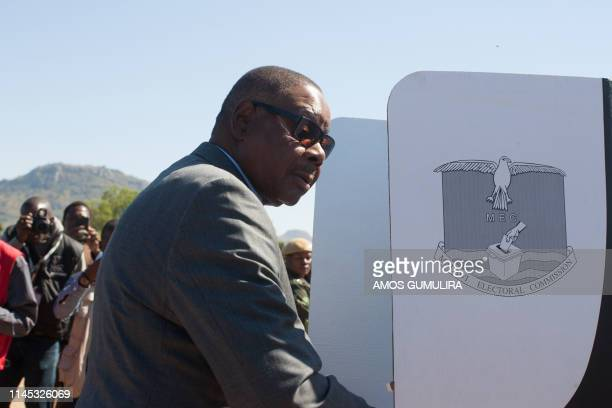 Malawi's President Arthur Peter Mutharika seeks privacy in a polling booth prior to casting his vote at Goliati Primary School at his home village...