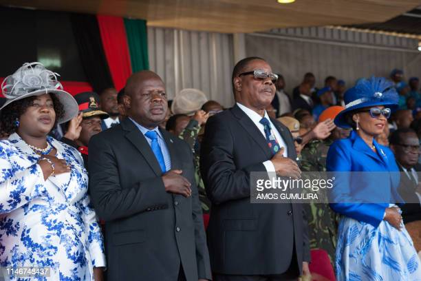 Malawi's President elect Arthur Peter Mutharika his wife Gertrude the Vice president elect Everton chimulirenji and his wife Ruth sing the national...