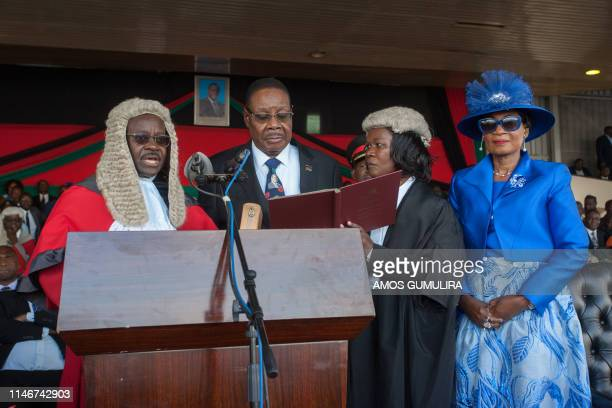 Malawi's President elect Arthur Peter Mutharika is sworn in for his second term by Chief Justice Andrew Nyirenda and Registrar of the high Court and...