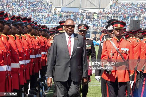 Malawis President elect Arthur Peter Mutharika who was already sworn in two days ago inspects the military parade during his inauguration at Kamuzu...