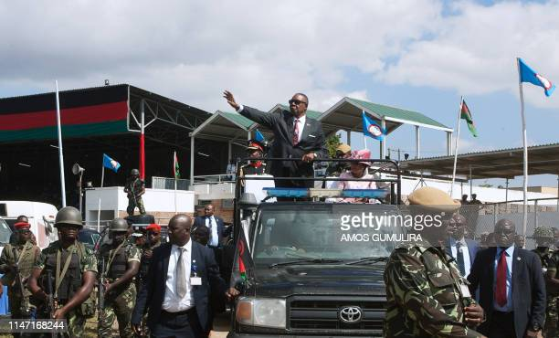 Malawis President elect Arthur Peter Mutharika who was sworn in two days prior waves at supporters as he leaves Kamuzu Stadium in Blantyre May 31...