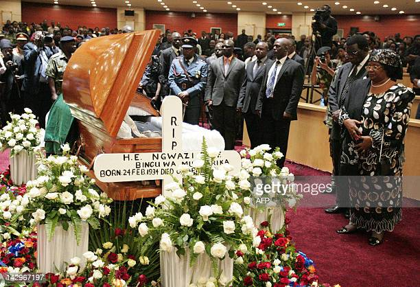 Malawi's President Joyce Banda standing next to her husband retitred Chief Justice Richard Banda leads people in paying their last respects to former...