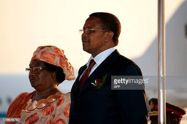 Malawi's President Joyce Banda stands alongside Tanzanian President Jakaya Kikwete at the Kamuzu International Airport in Lilongwe on August 16 ahead...