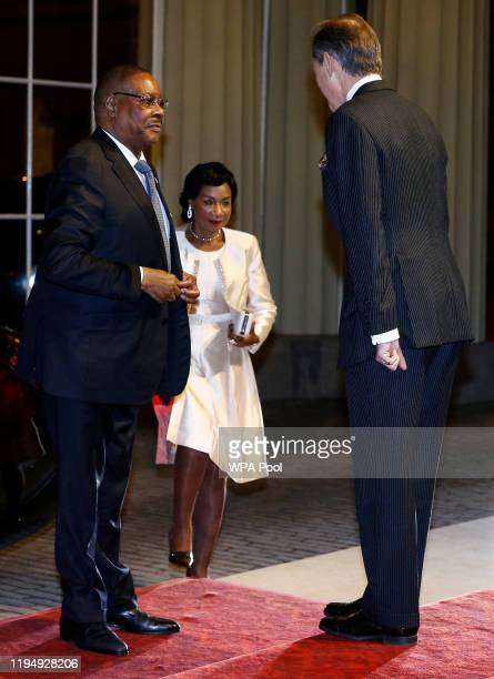Malawi's President Peter Mutharika arrives as Prince William Duke of Cambridge and Catherine Duchess of Cambridge host a reception to mark the...