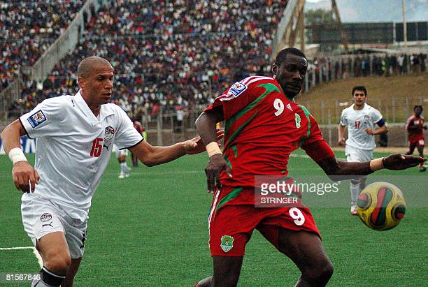 Malawi's Russell Mwafulirwa is chased by Egypt's Wael Gomaa during the 2010 World CupAfrican Nations Cup Group 12 qualifying match at Kamuzu Stadium...
