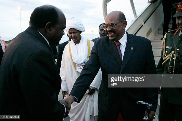 Malawi's speaker of house for the Parliament Henry Chimunthu Banda welcomes Sudan's President Omar ElBashir at Kamuzu International Airport in the...