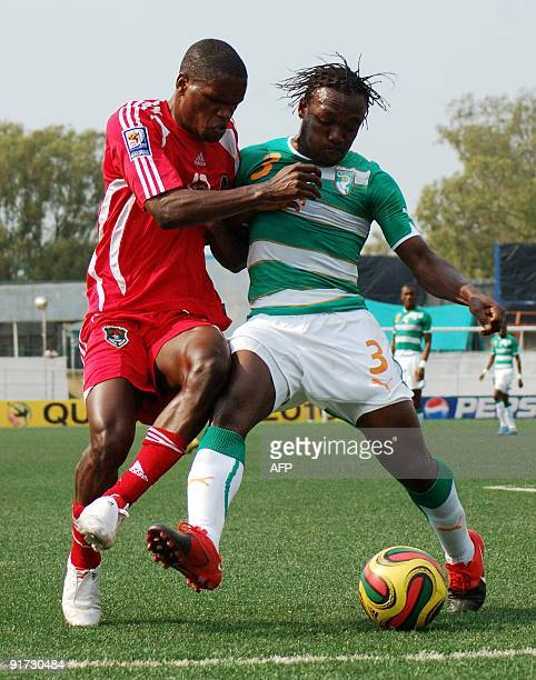 Malawi's Victor Nyirenda and Ivory Coast's Arthor Boka fight for the ball during their World Cup 2010 qualifier game at Kamuzu Stadium on October 10...