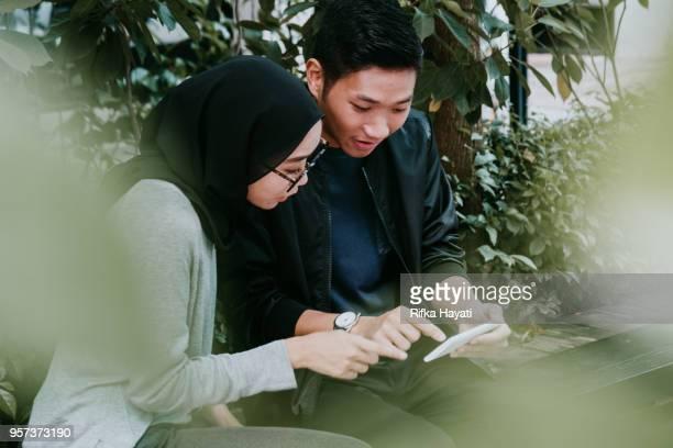 malay couple - rifka hayati stock pictures, royalty-free photos & images