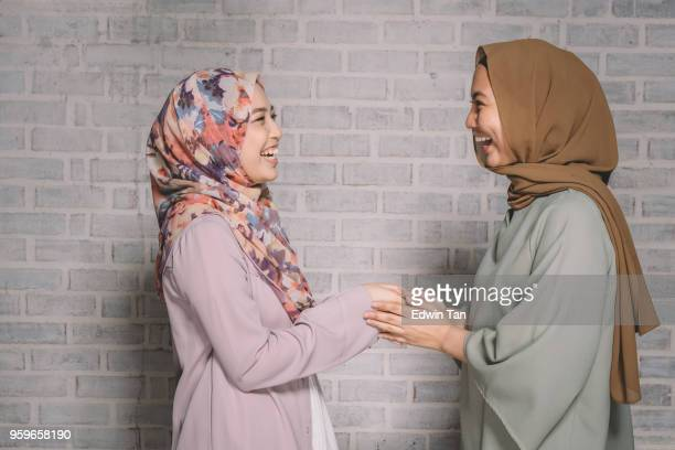 2 malay female greeting to each other