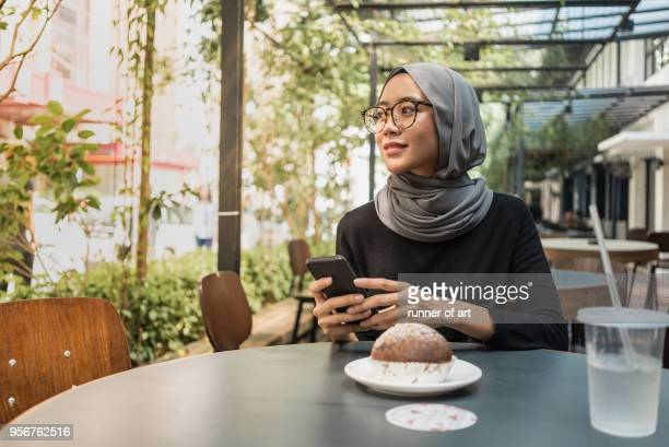 Malay girl with hijab with her smartphone