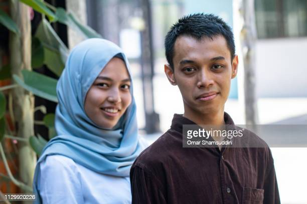 Malay guy with a girl friend in hijab