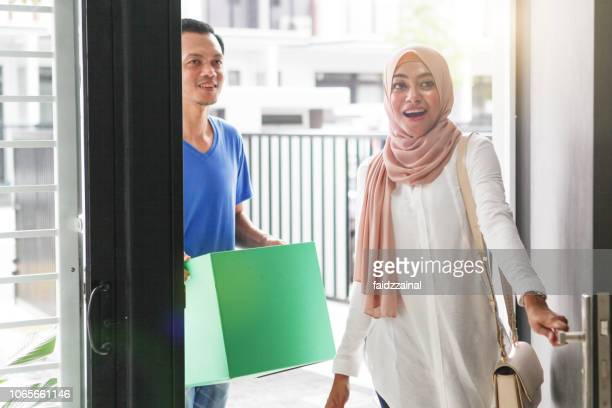malay muslim couples moving in to a new home - muslim couple stock pictures, royalty-free photos & images
