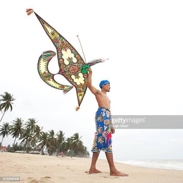 malay with traditional kite - hugh sitton stock-fotos und bilder