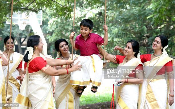 Malayali community women erect special swings on the occasion of Onam festival on September 3 2017 in Kerala India Onam is an annual harvest festival...