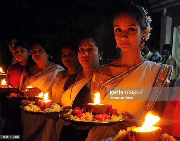 Malayali women dressed in traditional attire take out procession for Vilakku Pooja on the occasion of Makar Sankranti on January 15 2016 in Indore...