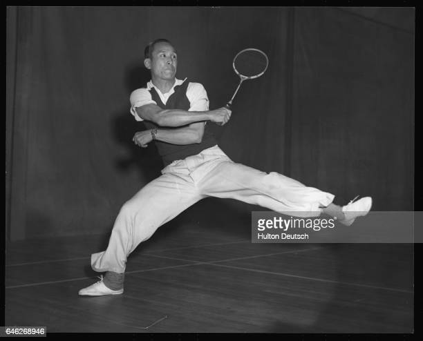 Malayan badminton player Ong Poh Lin in action at a team practice at the Wimbledon Squash and Badminton Club