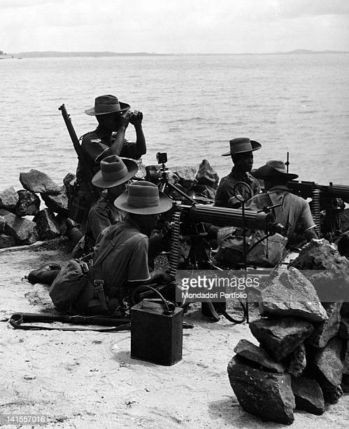Malayan machinegunners exercising in the channel of Seletar Singapore July 1939