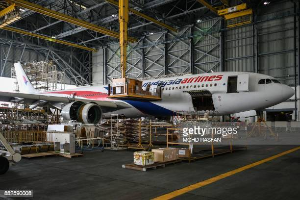 A Malaysia Airlines Airbus A330300 is seen inside a hangar at an engineering complex adjacent to the Kuala Lumpur International Airport in Sepang...