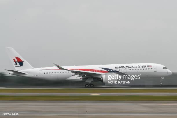 A Malaysia Airlines Airbus A350 aircraft lands after making a flyby at Kuala Lumpur International Airport in Sepang outside Kuala Lumpur on November...