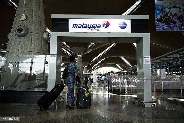 A Malaysia Airlines flight attendent walks at Kuala Lumpur International Airport in Sepang on July 21 2014 Malaysia Airlines said it would offer full...