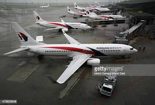 Malaysia Airlines ground staff work on the tarmac outside the Kuala Lumpur International Airport on June 2 2015 in Sepang Malaysia Chief Executive...