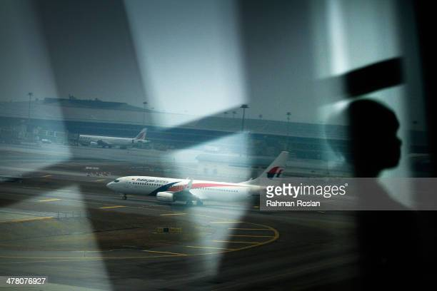 Malaysia Airlines plane is seen on the tarmac at Kuala Lumpur International Airport on March 12, 2014 in Kuala Lumpur, Malaysia. Officials have...