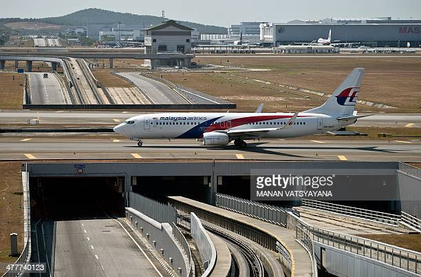 A Malaysia Airlines plane makes its way on the runway at Kuala Lumpur International Airport in Sepang on March 11 2014 Malaysia has expanded its...