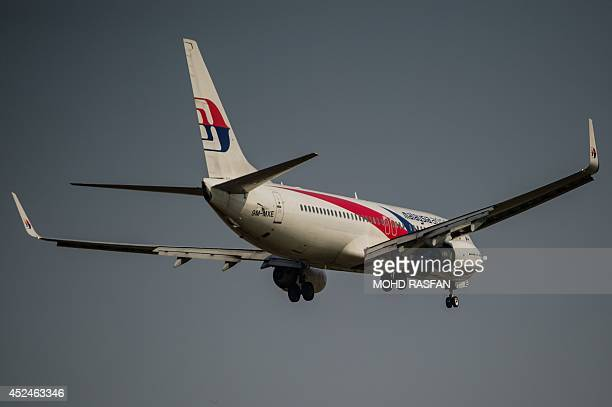 A Malaysia Airlines plane prepares for landing at the Kuala Lumpur International Airport in Sepang outside Kuala Lumpur on July 21 2014 Malaysia...