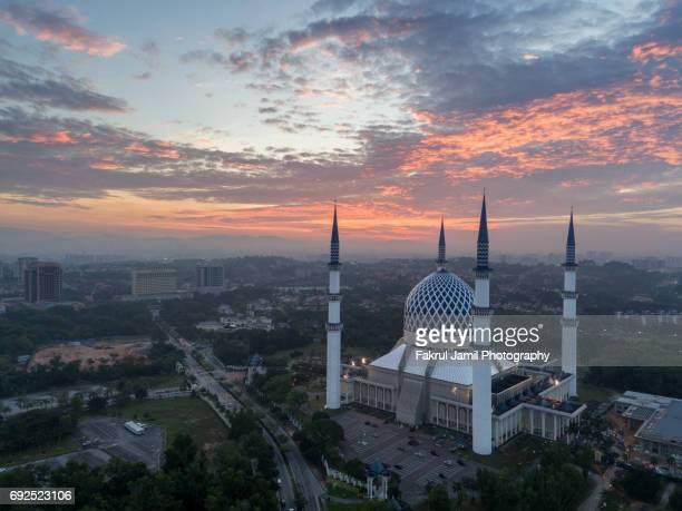 malaysia, circa 2017 - aerial photo of a mosque with fiery skies - shah alam stock photos and pictures
