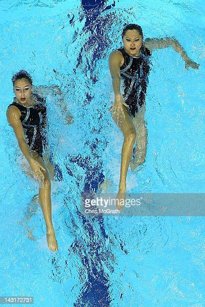Malaysia compete in the Duets Free Routine during the FINA Olympic Games Synchronised Swimming Qualification event at the London Aquatics Centre on...
