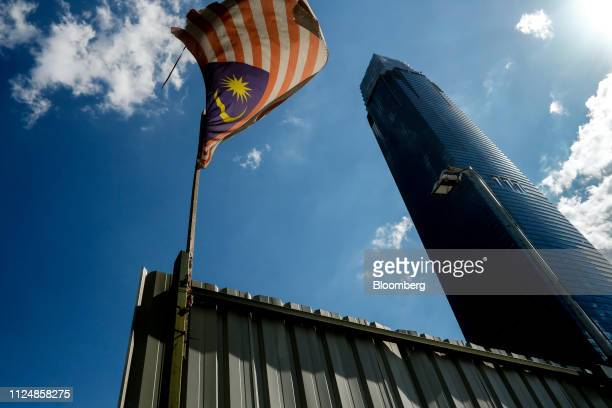 A Malaysia flag flies at a gate neat the under construction Exchange 106 building on the site of the Exchange TRX precinct in Kuala Lumpur Malaysia...