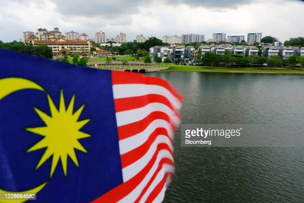 A Malaysia flag flies in Putrajaya Malaysia on Wednesday Sept 23 2020 Malaysias Prime Minister Muhyiddin Yassin urged people to reject moves to...