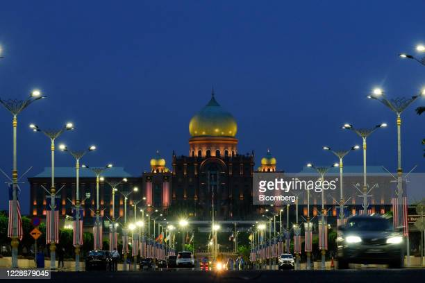 Malaysia flags hang from lamposts near the Perdana Putra the office complex of the Prime Minister of Malaysia in Putrajaya Malaysia on Wednesday Sept...
