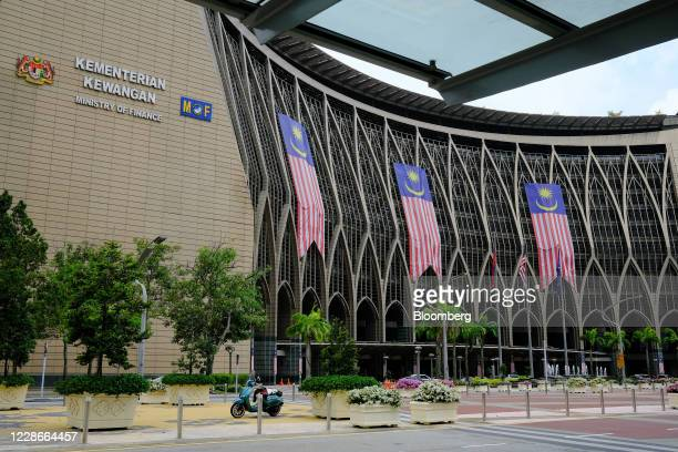 Malaysia flags hang from the Ministry of Finance building complex in Putrajaya Malaysia on Wednesday Sept 23 2020 Malaysias Prime Minister Muhyiddin...