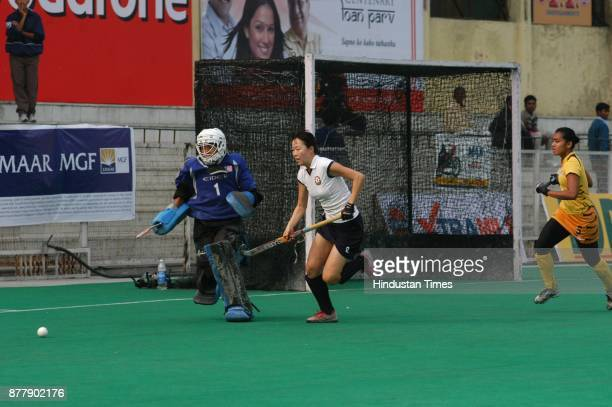 Malaysia goal keeper Yahya Farh Ayuni and Azerbaijan player Mammadova Zhun in action during Lal Bahadur Shastri four nation hockey tournament at...