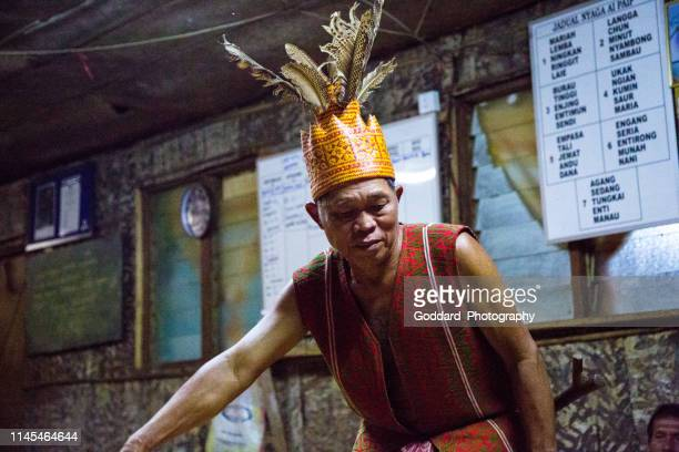 malaysia: iban traditional dance - longhouse stock photos and pictures