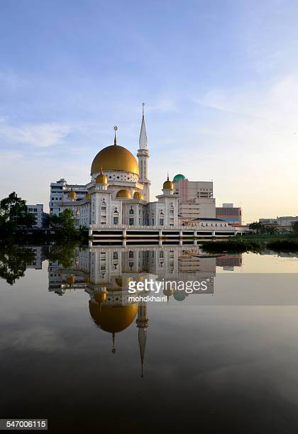 Malaysia, Klang, Holy Mosque, Symmetrical view of white mosque with golden dome reflecting in river