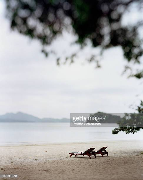 malaysia, langkawi, two sun loungers on beach - schlebusch stock pictures, royalty-free photos & images
