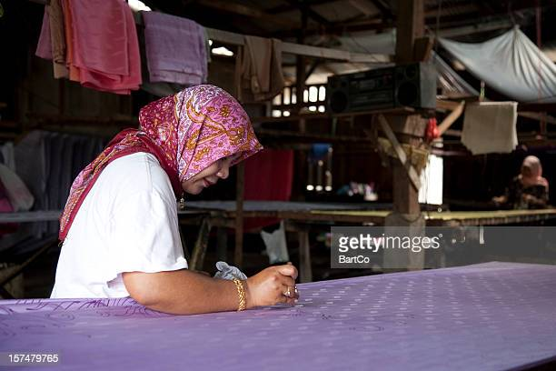 Malaysia, making batik, colorful clothes.