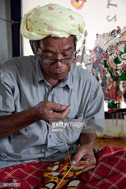 malaysia, making shadow puppet, wayang kulit. - shadow puppet stock photos and pictures