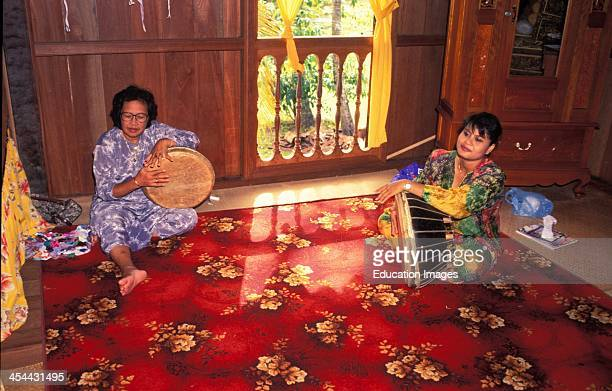 Malaysia Malay House In Kuching The Capital Of Sarawak In West Borneo Two Women Sit With Drums