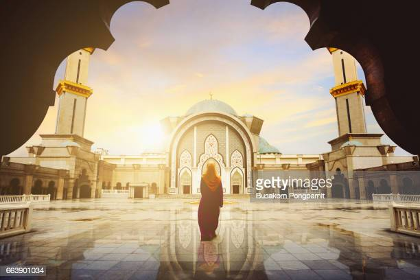 malaysia mosque with muslim pray in malaysia, female malaysian muslim pray at mosque, kuala lumpur malaysia - god stock pictures, royalty-free photos & images