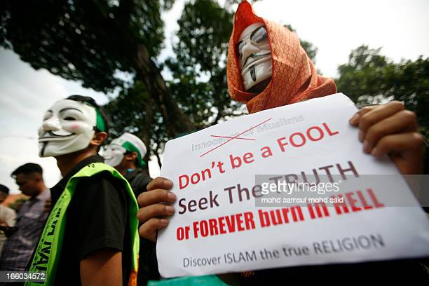 Malaysia muslim show the poster in front of US embassy during protest film Innocence of Muslims, in Kuala Lumpur September 21, 2012. Muslims...