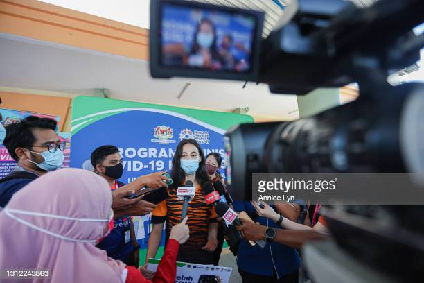 Malaysia Olympic artistic gymnast Farah Ann Abdul Hadi fields questions during a press conference after receiving the Pfizer BioNTech COVID-19...