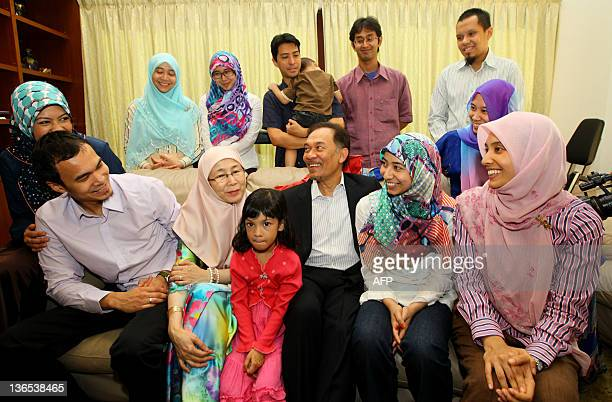Malaysia opposition leader Anwar Ibrahim share a lights moments with his family at their home in Kuala Lumpur on January 8 2012 on the eve of the...