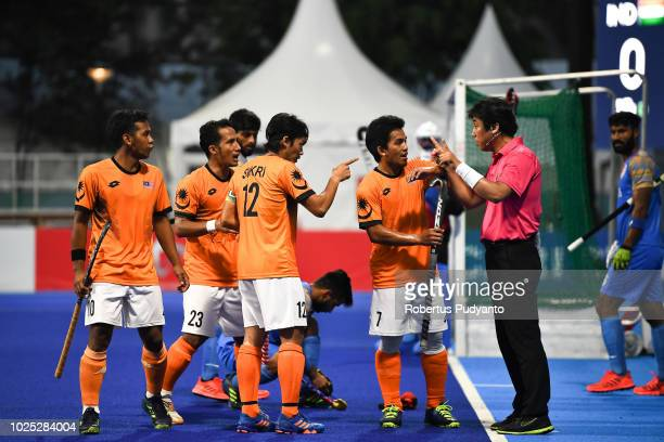 Malaysia players protest to the referee during Men's Hockey Semifinal match between Malaysia and India at GBK Senayan on day twelve of the Asian...