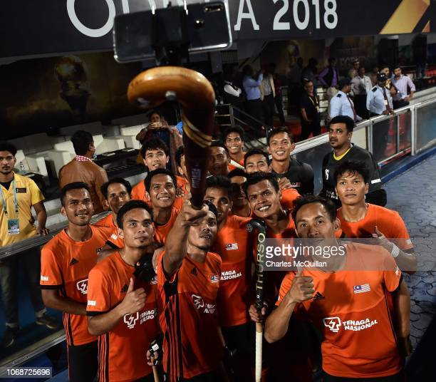 Malaysia pose with a selfie camera following the FIH Men's Hockey World Cup Pool D match between Pakistan and Malaysia at Kalinga Stadium on December...