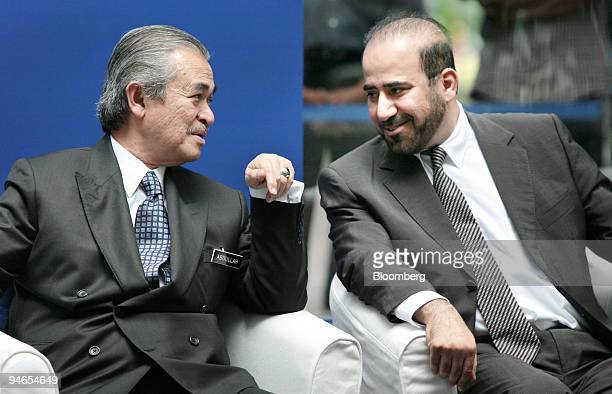 Malaysia Prime Minister Abdullah Ahmad Badawi left speaks with Abdullah Sulaiman chairman of Al Rajhi Bank Malaysia at a news conference during the...