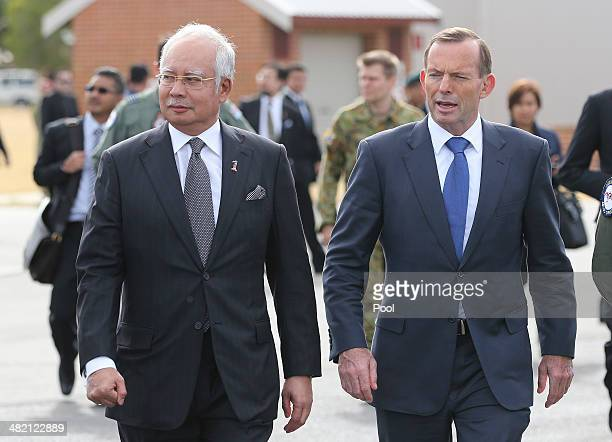 Malaysia Prime Minister Najib Razak and Australian Prime Minister Tony Abbott walk along the tarmac on there way to meet crews involved in the search...